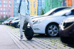 Electric transport compare to diesel fuel cars. Electric balancing unicycle stock image