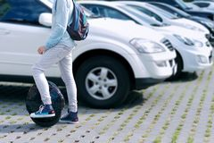 Electric transport compare to diesel fuel cars. Electric balancing unicycle royalty free stock photo