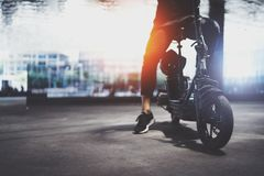 Electric urban transportation.Young man ready to ride his electric scooter bike in the center of a city. Electric urban transportation.Young man ready to ride royalty free stock images