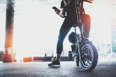 Electric urban transportation.Young man ready to ride his electric scooter bike in the center of a city. Innovative. Transport royalty free stock image