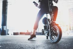Electric urban transportation.Young man ready to ride his electric scooter bike in the center of a city. Innovative. Transport royalty free stock images