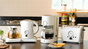 The electric utensil. Three of electric utensils in the kitchen, electric kettle, coffee blender and bread toaster Stock Photo