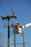 Electric Utility Lineman. Working on power lines Stock Photo