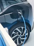 Electric vehicle being plugged in Stock Photography