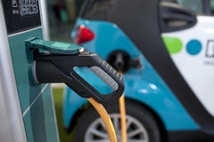 Electric vehicle in car sharing station. Stock Photos