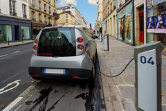 Electric vehicle in car sharing station Stock Image
