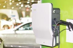 Electric vehicle charging Ev station with plug of power cable supply for Ev car.  royalty free stock photo