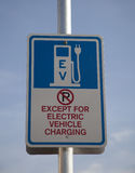Electric vehicle charging sign. Sign restricting parking to only those electric vehicles which require recharging of their batteries Royalty Free Stock Photos