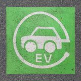 Electric vehicle charging station sign paint on asphalt royalty free stock images
