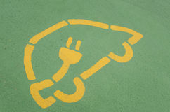 Electric Vehicle Charging Station Sign on Asphalt Stock Photo
