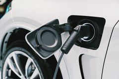 Free Electric Vehicle Charging System. EV Fuel For Advanced Hybrid Car. Modern Automobile Technology Or Advanced Energy Concept Royalty Free Stock Photography - 90109527