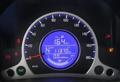 Electric vehicle dashboard charging. Electric vehicle dashboard.It is the control panel night screen. At the moment, it`s charging.It is a home electric car made royalty free stock photo