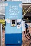 Electric vehicle fast charging station. Dec 22, 2017 Portland Oregon - A Electric vehicle fast charging station sits in downtown near the water front.  One of Royalty Free Stock Photo