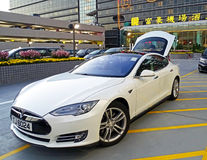 Electric vehicle model S of the brand Tesla Motors. Chek Lap Kok, Hong Kong - February 8, 2016: An electric vehicle model S of the brand Tesla Motors parked at Royalty Free Stock Images