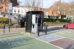 Electric vehicle recharging point in Ayr, Scotland. Electric vehicle recharging point in Burns Statue square, Ayr, South-Ayrshire, Scotland with adjacent Stock Photography