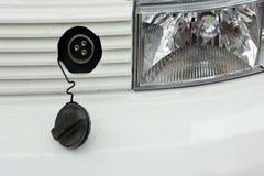 Electric vehicle's plug royalty free stock photo