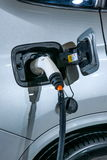 Electric vehicles and electric vehicle charging stations Royalty Free Stock Photos