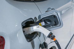 Electric vehicles and electric vehicle charging stations Royalty Free Stock Image
