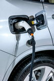 Electric vehicles and electric vehicle charging stations Stock Photos