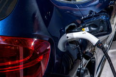 Electric vehicles and electric vehicle charging stations Stock Image