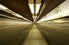 Electric walkway in perspective. Endless electric walkway at a Paris metro station Stock Photos
