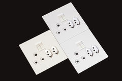 Electric Wall Mount Sockets and Switches on Black Background Stock Photo