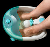 Electric water feet massager Stock Image