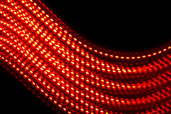 Electric wave. Close up of red lights shot in studio to create a bright electric wave Royalty Free Stock Photos