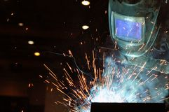 Electric welder brews steel at the factory stock photo