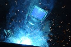 Electric welder brews steel at the factory stock photography