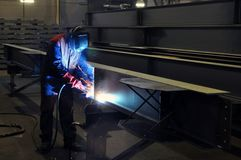 Electric welder brews steel at the factory stock images