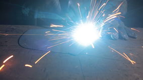 Electric welding, closeup, flying sparks. stock footage