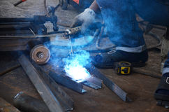Electric welding. Welding is a fabrication or sculptural process that joins materials, usually metals or thermoplastics, by causing coalescence. This is often Royalty Free Stock Images