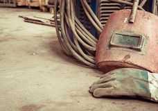 Electric welding machine, electric wire, masks, gloves and tongs, are very old Stock Images