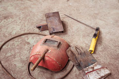 Electric welding machine, electric wire, masks, gloves and tongs, are very old Royalty Free Stock Photography