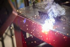 The sparking light from the arc welding process. The electric welding process.The sparking light from the arc welding process Stock Photos