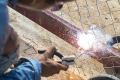 Electric welding. On worker hand outdoor stock photos
