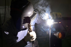 Electric welding at workshop 2. Man doing electric welding in a workshop background Royalty Free Stock Photos