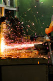 Electric wheel cutting on steel structure in factory Stock Image