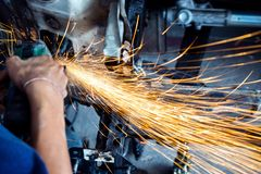 Electric wheel grinding on chassis of a car. Auto body repair shop Stock Image