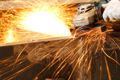 Electric wheel grinding. On steel structure in factory Stock Photography