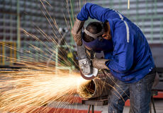 Electric wheel grinding on steel structure. In factory Stock Photos