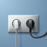Electric white and black plugs with plastic socket Royalty Free Stock Photo