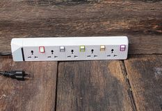Electric white socket power bar  or extension block and one plu Royalty Free Stock Images