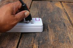 Electric white socket power bar  or extension block and one plu Royalty Free Stock Photo