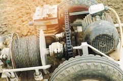 Electric winch or cultivator for of agricultural work, farming, cultivation, agro-industry, the chain mechanism and gear. close up.  stock images