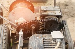 Electric winch or cultivator for of agricultural work, farming, cultivation, agro-industry, the chain mechanism and gear. close up.  royalty free stock photo