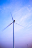 Electric wind generator or turbine spinning Royalty Free Stock Image