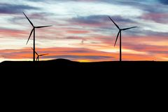 Electric wind turbines, backlighting stock photography