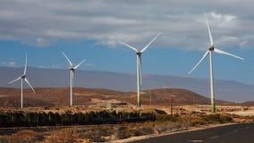 Electric wind turbines farm. Blue sky background Royalty Free Stock Photos